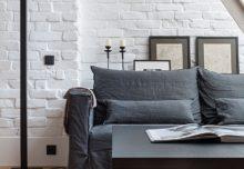 Biała, ceglana ściana w męskim stylu