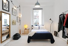 Jasna sypialnia z pomalowaną na biało ceglaną ścianą